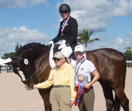 GK Elite Sport Adult Amateur Achievement Dr. Nancy Binter riding Arend Z pictured with Husband and Katie Riley of GK Elite Sport