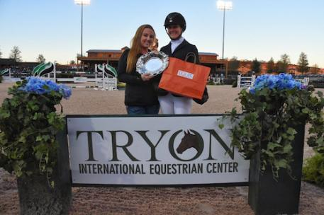 "Heather Caristo-Williams accepted the Equis Boutique ""Best Presented Horse"" Award from Alex West of Equis Boutique during during Tryon Fall 5."