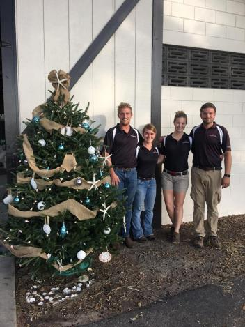 The Hermitage Florida crew and their Christmas tree