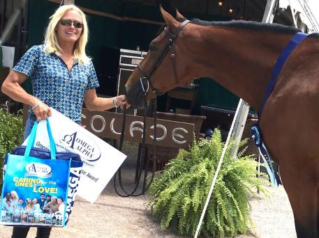 HJ Noteworthy, with rider Holly Shepherd, wins the Omega Alpha Healthy Horse Award at the Summer in the Rockies show series at the Colorado Horse Park