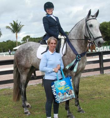 Horquidea MVL, ridden by Ana Daniela Campos-Siberio, wins the Omega Alpha Healthy Horse Award. Pictured with Tara Stegen (front)