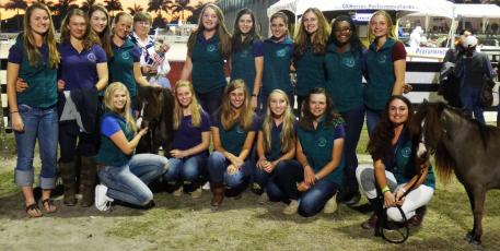 The Horse of Course sponsored Lendon Gray's Youth Dressage Festival by rewarding Dressage4Kids students with polos and embroidered saddle pads. Pictured is Lendon Gray with her Dressage4Kids students at the Adequan Global Dressage Festival.