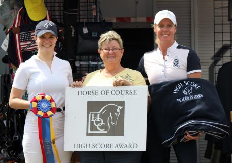 The Horse of Course CEO Beth Haist (middle)  with prior High Score Award winners Mackenzie Rath (left) and Missy Fladland (right)  at the Adequan Global Dressage Festival in 2016
