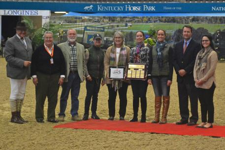 The Howard Lewis Family accepted the Award for the USHJA Zone 5 Horseman of the Year presented by Diane Carney, Kevin Price and Emma Nichols of USHJA.