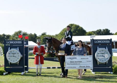Ireland's Shane Sweetnam won the $30,000 LONGINES Rider Challenge, receiving a watch and a check for $30,000 from Pascal Savoy, Brand President, Longines. © Shawn McMillen