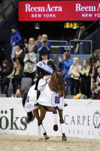 Germany´s Isabell Werth and Emilio celebrating victory in the eighth leg of the FEI World Cup Dressage Western European League series at Gothenburg, Sweden.