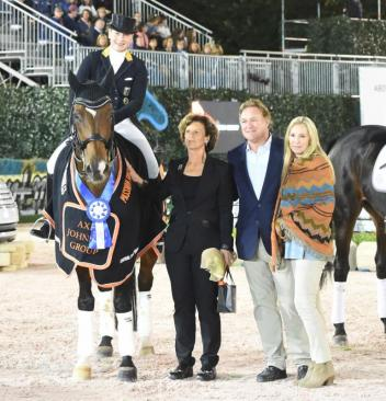 Isabell Werth and El Santo NRW in their winner's presentation with Mark and Katherine Bellissimo, and Antonia Johnson of Axel Johnson Group