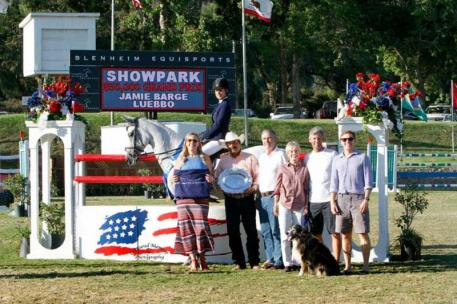 Jamie Barge and Luebbo celebrate the win in the $50,000 Showpark Grand Prix with family and friends