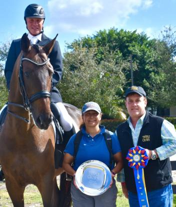 Triple Crown Dressage Excellence Award winner Jan Ebeling  (left) with groom Stephanie Busley (center) and Triple Crown Feed Florida Rep  Craig Bernstein (right)