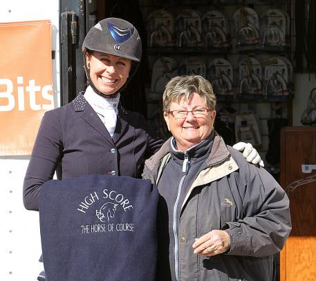 Jessica Jo Tate is presented with The Horse of Course High Score Award by Beth Haist, CEO of The Horse of Course Inc.