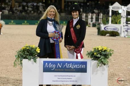 eg Atkinson of Town and Country Realtor presents Jessica Springsteen with the Leading Lady Rider Award.