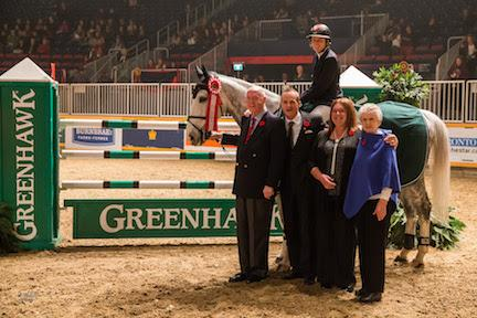 Jill Henselwood and Farfelu du Printemps are presented as the winners of the opening round of competition in the 00,000 Greenhawk Canadian Show Jumping Championship on Friday, November 6, at the Royal Horse Show® in Toronto, ON.