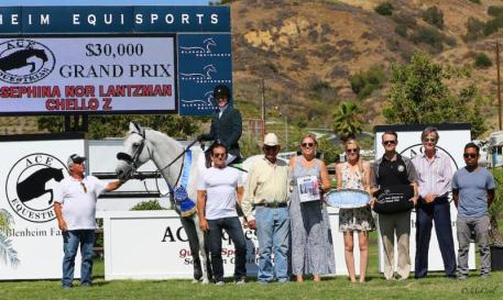 Lantzman celebrates the win with her father, Fabio (far left), her groom Adalit Sierra (far right) along with ACE Equestrian representatives Kendra and Devon Bridges, as well as Melissa Brandes and Robert Ridland of Blenheim EquiSports