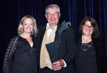 Owners Augustin and Christine Walch accept the award on behalf of Rio Grande, who was inducted into the Jump Canada Hall of Fame in the category of Jumper Horse, from presenter Erynn Ballard (left).