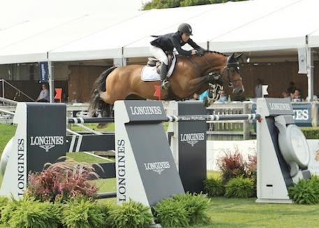 Karen Polle of Japan and With Wings leaped to the top of the $250,000 Hampton Classic Grand Prix, Presented by Longines. (McMillen photo)