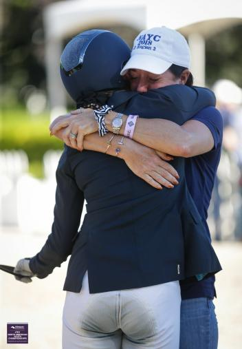 Karen Lipp hugs student and Gold Medal American Youth Dressage Champion Caroline Garren