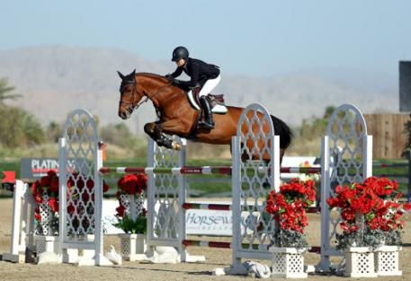 Kasey Ament and Zuidhoeve on their way to a $50,000 HorseWare Ireland Grand Prix win.