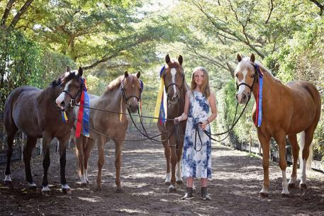 Kat Fuqua and her herd of champion ponies (Photo: Anne Gittins Photography)