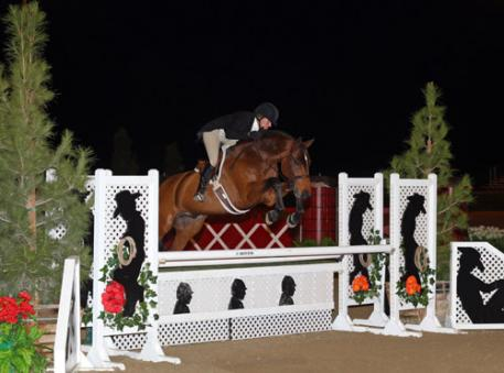 Kelley Farmer and Dalliance on their way to a 00,000 USHJA International Hunter Derby win at National Sunshine Series II in Thermal, CA.