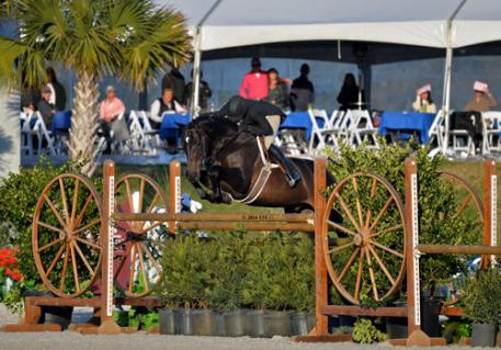 Kelley Farmer and Mindful on their way to a 00,000 USHJA International Hunter Derby win.