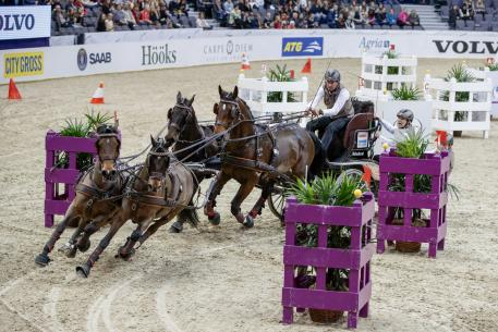 Koos de Ronde from Netherland with his Four-in-Hand team. FEI World Cup™ Final Driving Photo