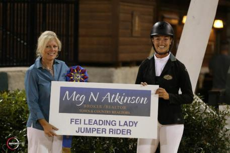 eg Atkinson of Town & Country Realtors presented Kristen Vanderveen with the Leading Lady FEI Jumper Rider Award.