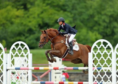 Laura Chapot and Quointreau Un Prince on their way to a $75,000 AIG Grand Prix win.