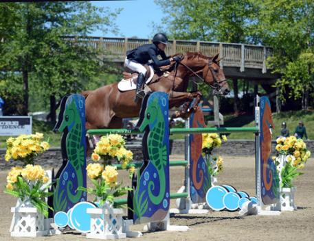Laura Chapot and Quointreau Un Prince on their way to a $25,000 SmartPak Grand Prix win.