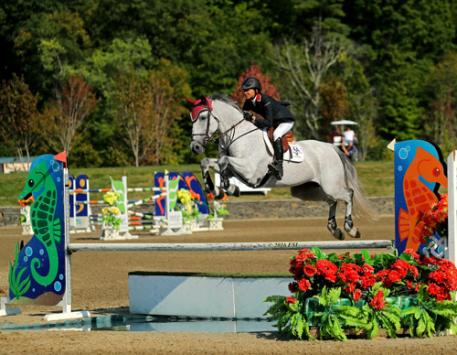 Laura Chapot and Thornhill Kate on their way to a $50,000 HITS Grand Prix win.