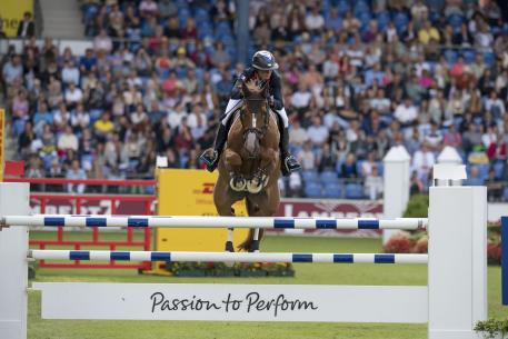 : French rider Penelope Leprevost galloped to victory with Flora de Mariposa in the first Team and Individual qualifier at the FEI European Jumping Championships 2015 in Aachen, Germany today. (FEI/Dirk Caremans)