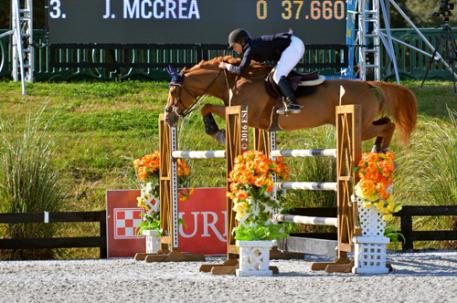 Lisa Goldman and Morocco on their way to a $25,000 SmartPak Grand Prix win.