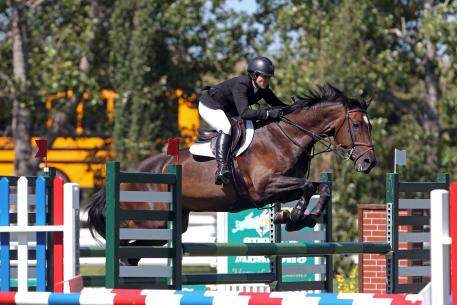 Liz Atkins at Spruce Meadows with her grand prix mount, Undine. Photo Cansport Photo