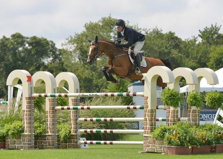Lorcan Gallagher of Ireland guided Esquina Van Klapscheut to the top of the $20,000 Royalton Farms Jumper Challenge at the Hampton Classic. McMillen photo)