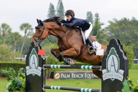 At only 15 years of age, Lucy Deslauriers of the United States topped the  2015 Artisan Farms Under 25 Grand Prix Series riding Hester.