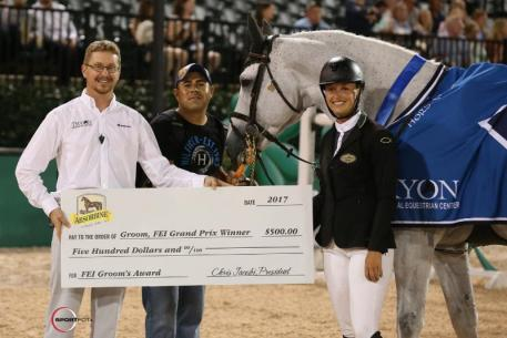 Luis Salvaras accepts the Absorbine FEI Groom's Award with rider Kristen Vanderveen and Lance Bennett of TIEC.