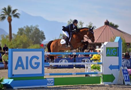Mandy Porter and Milano on their way to a AIG  Million Grand Prix win.