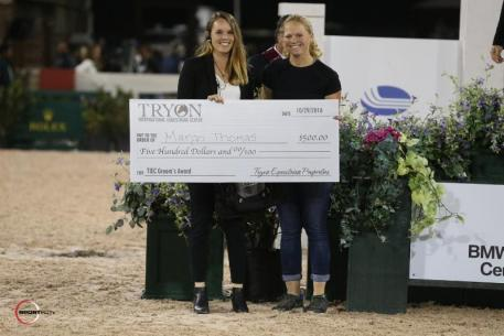 Margo Thomas accepts the Grooms' Initiative Award with Charly Miller of TIEC.
