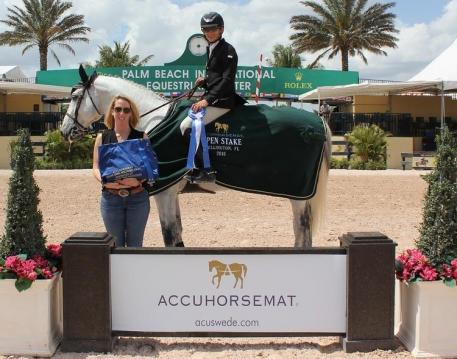 Mark Bluman and Thriller P win the Accuhorsemat 0,000 Open Welcome Stake at the Palm Beach International Equestrian Center