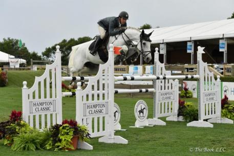 Matthew Metell with Donchalant in the 0,000 Jaguar Open Jumper Class at the Hampton Classic
