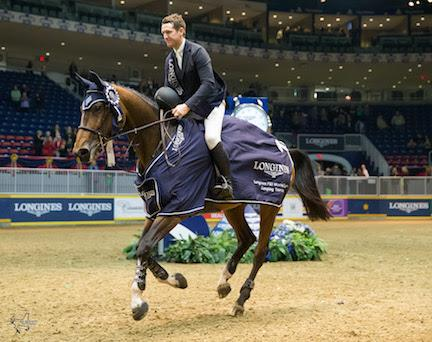 Mclain Ward and HH Azur, owned by Double H Farm, enjoy their victory gallop after winning the 32,000 Longines FEI World Cup™ Jumping Toronto on Wenesday, November 11.