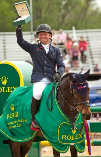 Michael Jung was all smiles when he received the Rolex watch for winning with FischerRocana FST at Rolex Kentucky.