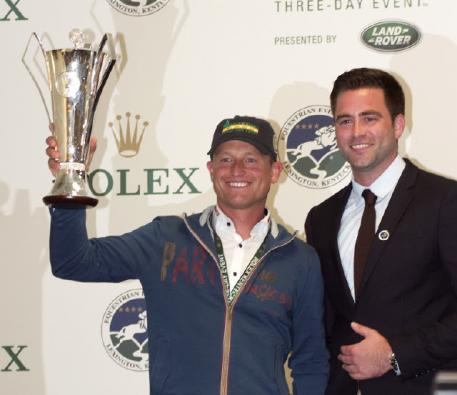 Michael Jung was pleased to receive a replica of the Rolex Grand Slam of Eventing trophy he won in 2016 from Rolex Watch USA's Kyle Younghans.