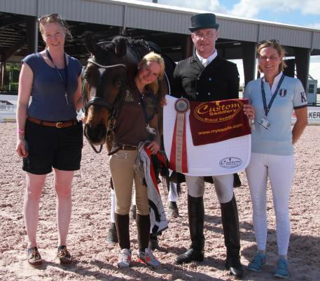 Michael Klimke (second from right) celebrates winning the Custom Saddlery MVR Award  with his mount Lemony's Nicket and his team at the Adequan Global Dressage Festival