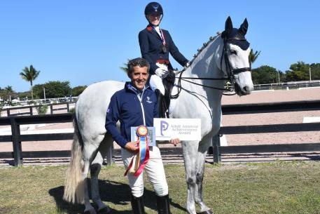 Dr. Cesar Parra was pleased to present the Piaffe Performance Adult Amateur Achievement Award to Michele Roark, riding her horse Cesar HHC