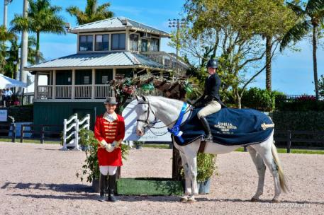Molly Sewell and MTM Caruso S in their presentation ceremony with ringmaster
