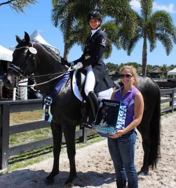Naima Moreira-Laliberté and Sancerre are presented with the Omega Alpha Healthy Horse Award at the Adequan Global Dressage Festival