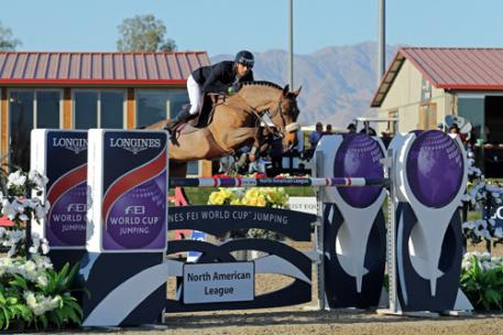 Nayel Nassar and Lordan on their way to a 00,000 Longines FEI World Cup - Jumping Thermal win.