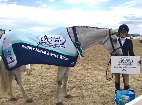 A beaming smile, and a beaming horse make for the perfect Omega Alpha Healthy Horse Award winners, Olivia Stordahl and Capri.
