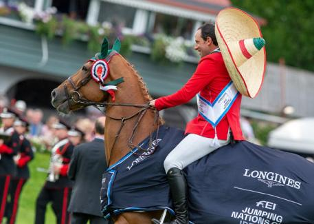 Patricio Pasquel celebrates in a sombrero after jumping two brilliant clear rounds with Babel to help Team Mexico to victory in the Longines FEI Jumping Nations Cup™ of Ireland in Dublin (IRL) today. (FEI/Jon Stroud)
