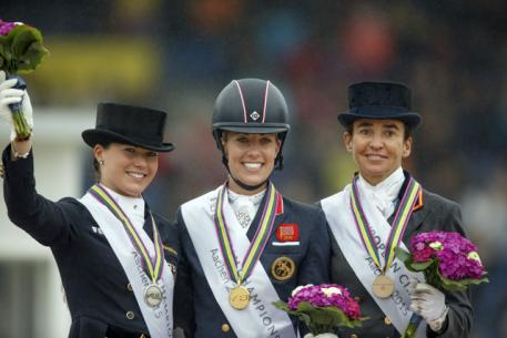 he Grand Prix Freestyle medallists on the podium at the FEI European Dressage Championships 2015 in Aachen, Germany today. (L to R) Kristina Bröring-Sprehe from Germany (silver), Britain's Charlotte Dujardin (gold) and Spain's Beatriz Ferrer-Salat (bronze). (FEI/Dirk Caremans)